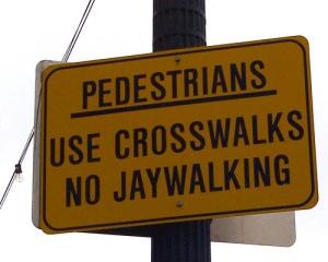 no-jaywalking-sign